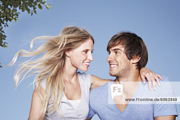 Germany  Cologne  Young couple embracing  smiling
