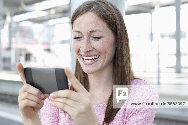 Young woman watching smart phone
