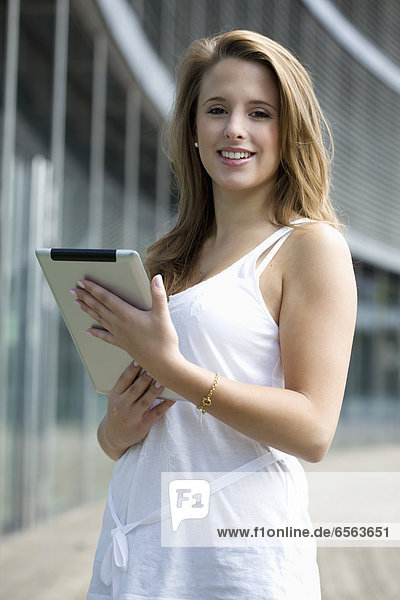 Europe  Germany  North Rhine Westphalia  Duesseldorf  Young student with digital tablet  smiling  portrait