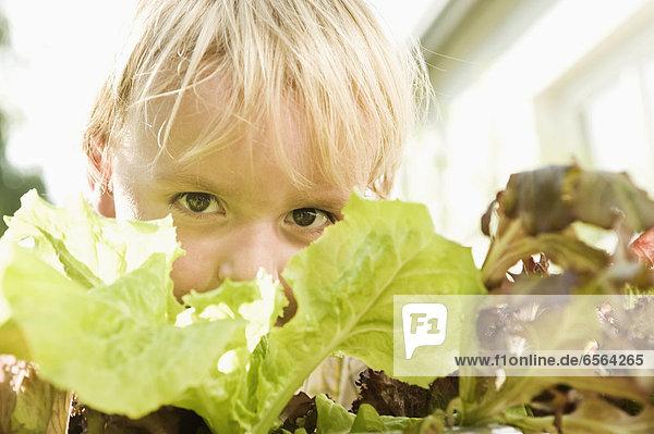 Boy with salad  portrait