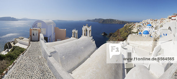Greece  View of Oia village with bell tower of Greek Orthodox Church at Santorini