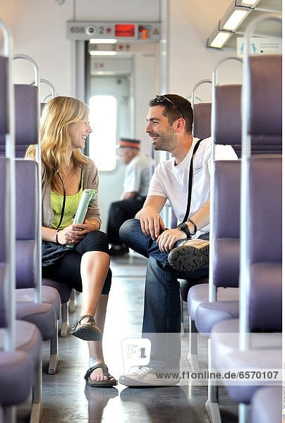 Young couple traveling by train. Young couple in a train *** Local Caption ***