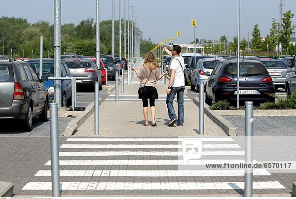 Young couple traveling by train. Young couple in the parking area of a station *** Local Caption ***
