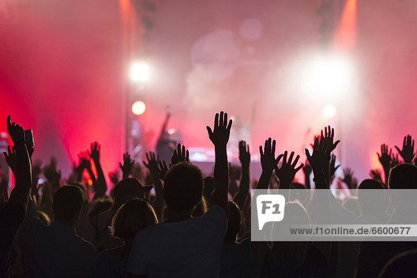 'Concert-goers with their hands up in the air during the concert of the U.S.-American hip hop group ''De La Soul'' performing live at the Lucerne Hall of the KKL  Blue Balls Festival  Lucerne  Switzerland  Europe'