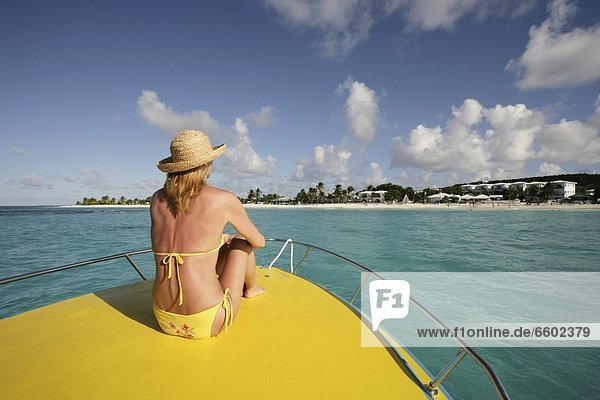 View Of Woman From Behind On Boat