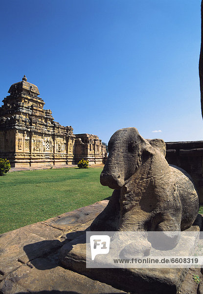 Hindu Temple Ruins And Cow Sculpture.