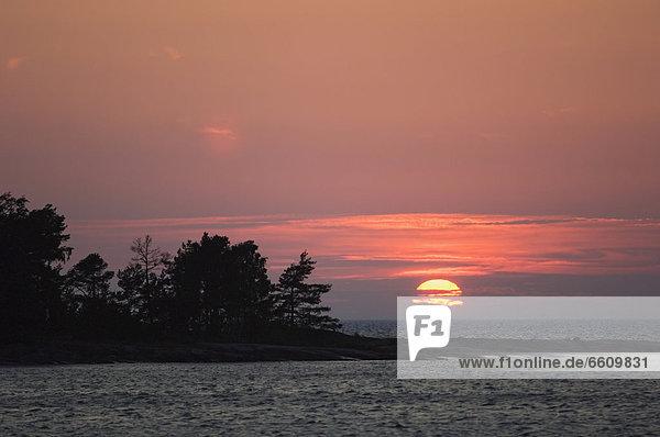 Sonnenuntergang  über  See  Vänersee