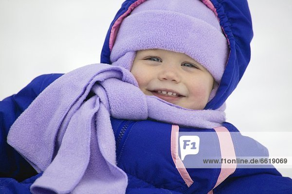 Toddler In A Snowsuit
