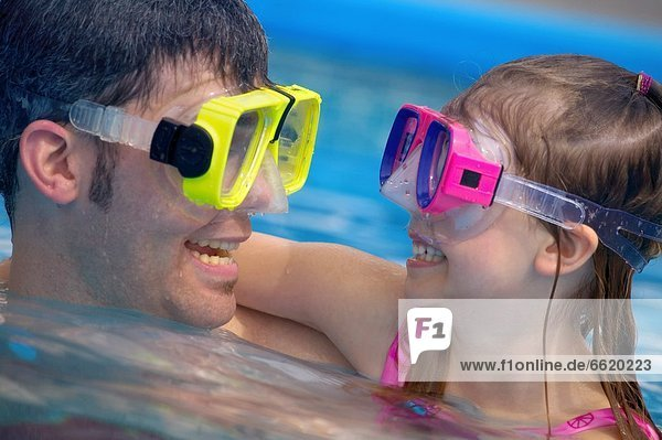 Portrait Of Father And Daughter Swimming