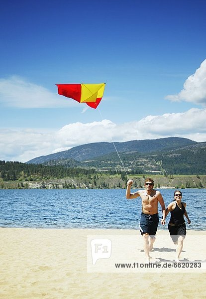 A Couple Fly A Kite