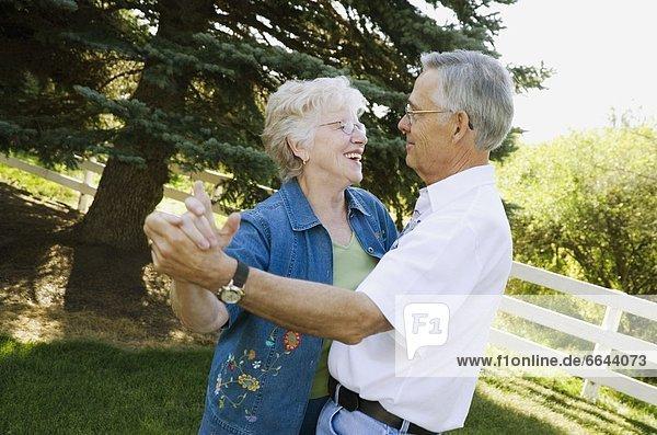 Elderly Couple Dancing Outside