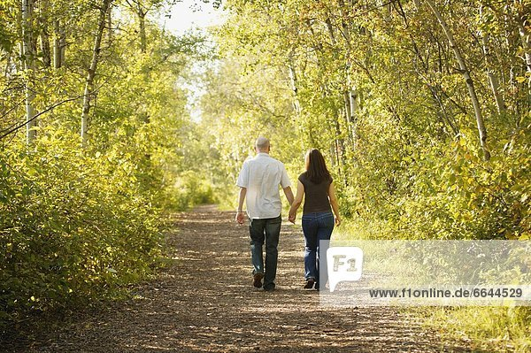 Couple Walking Down Path Together
