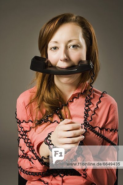 Woman Wrapped In Telephone Cord  Holding Receiver In Mouth