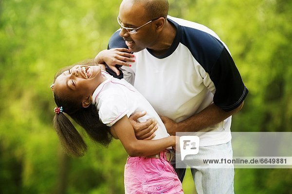 Father With Daughter In The Park