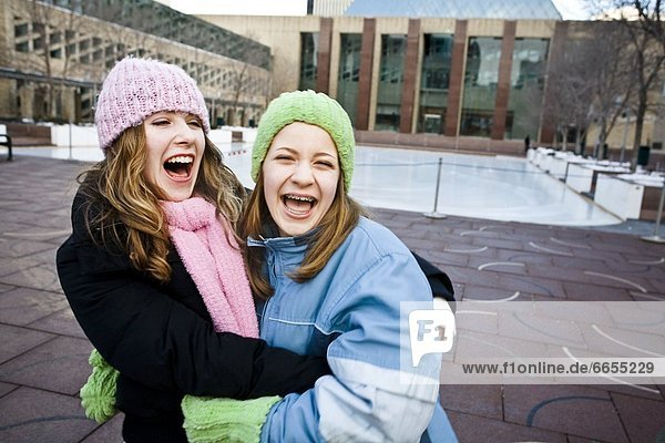 Two Friends Laughing Together