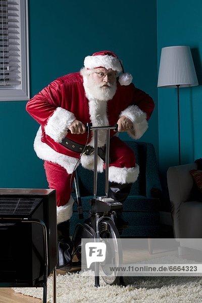 Santa Riding Stationary Bike