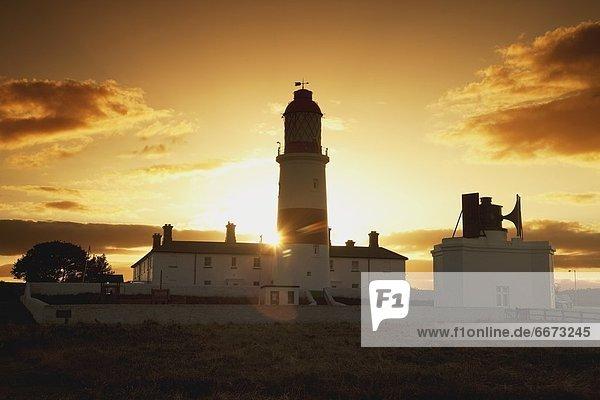 Sunset Behind Lighthouse