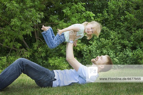A Father Playing With His Young Daughter