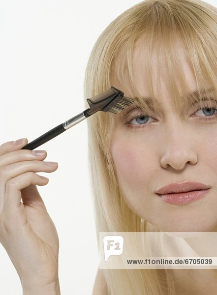 benutzen  Frau  Kosmetik  Bürste