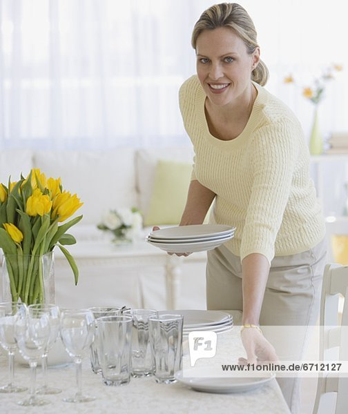 Woman setting table