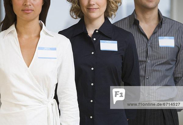 Wirtschaftsperson  Preisschild  Name  Kleidung  multikulturell
