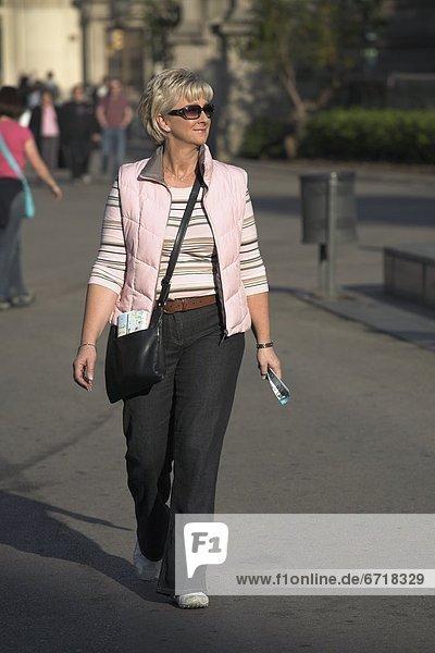 Woman Walking Up La Rambla  Barcelona  Spain