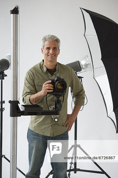Professional photographer in his studio