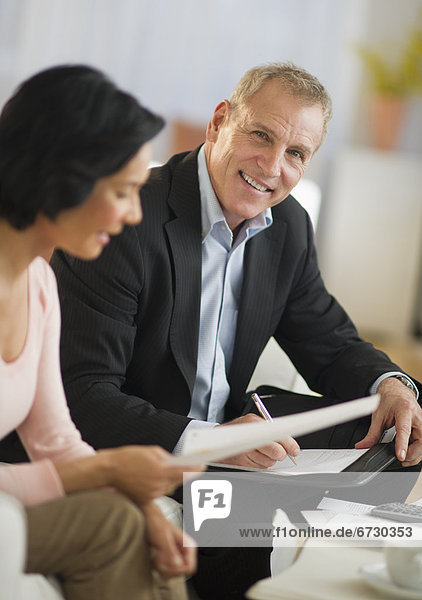 Woman talking to financial advisor