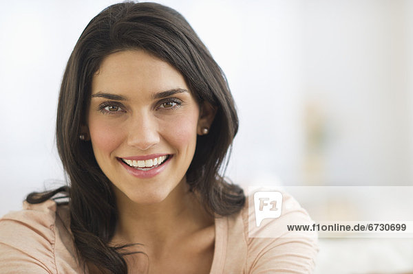 Portrait of young woman smiling