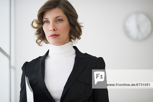 USA  New Jersey  Jersey City  portrait of businesswoman in office