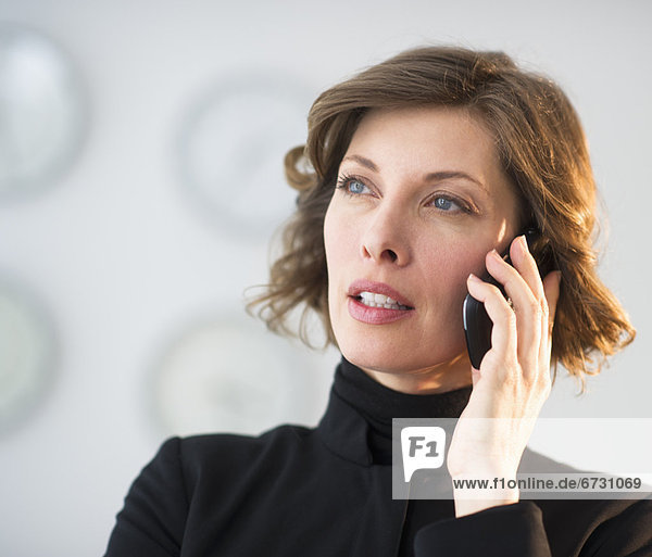 USA  New Jersey  Jersey City  woman talking on mobile phone