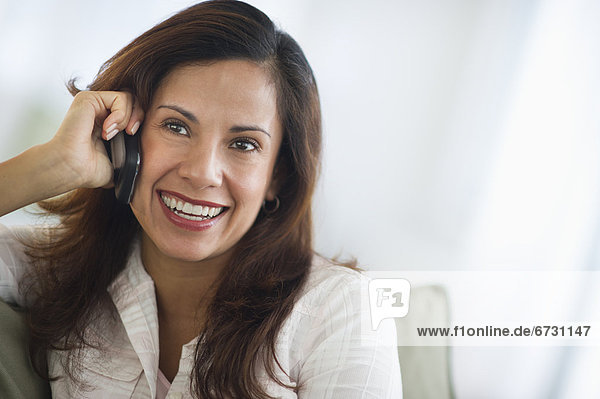 USA  New Jersey  Jersey City  smiling woman talking on mobile phone