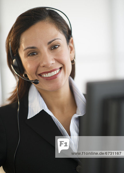 USA  New Jersey  Jersey City  smiling female customer service representative with headset
