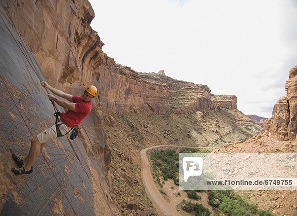 Mann-Klettern