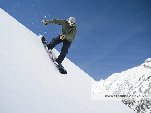 Mann  Snowboard  Himmel