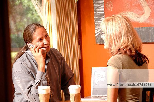 Couple having Coffee  Man on Cellphone