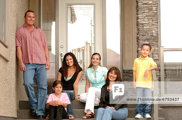 Family on Front Steps of House