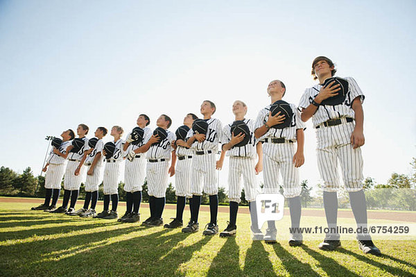 USA  California  Ladera Ranch  little league players (aged 10-11) on field