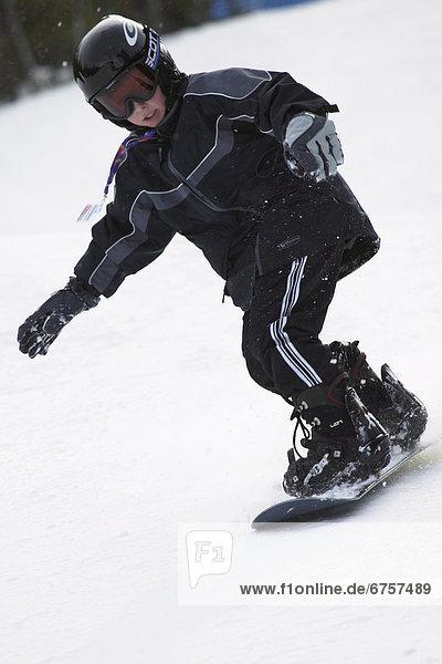 Boy Snowboarding  Alberta Rocky Mountains