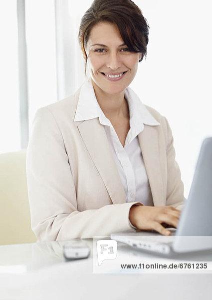 Portrait of businesswoman with laptop