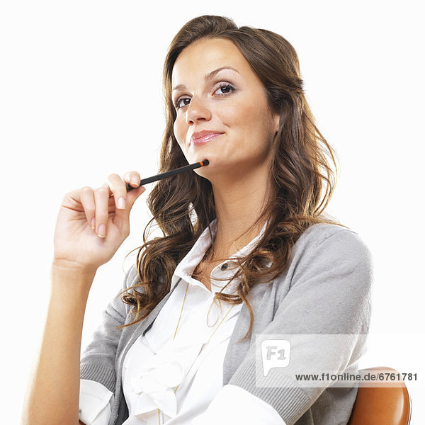 Bored business woman sitting on chair with pencil against white background