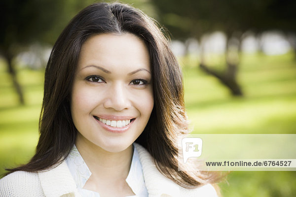Portrait of woman smiling in park