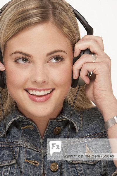 blond  Frau  Kopfhörer  Kleidung  hübsch