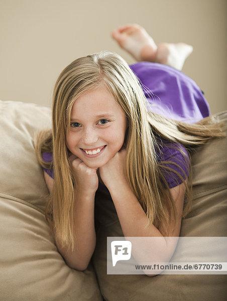 USA  Utah  Lehi  Portrait of girl (8-9) lying on sofa