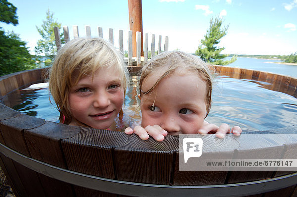 Little Girls in a Hot Tub at a Cottage  Muskoka  Ontario
