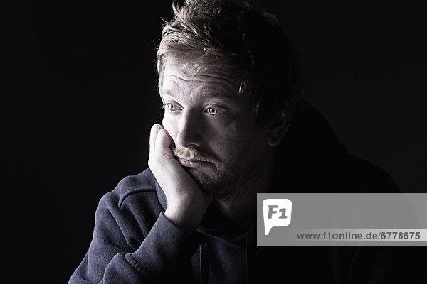Studio portrait of sad man
