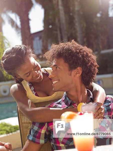 USA  Arizona  Scottsdale  Young couple at pool side bar