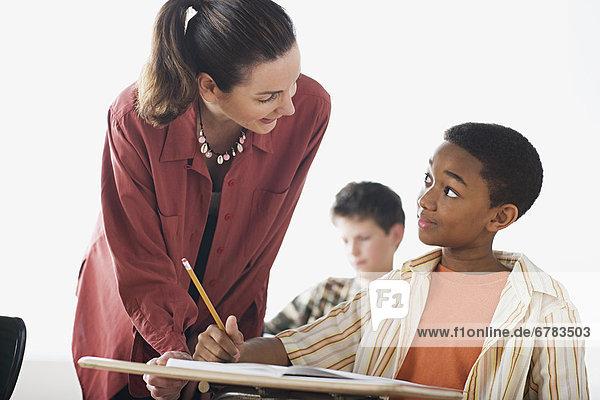 Teacher checking boys homework