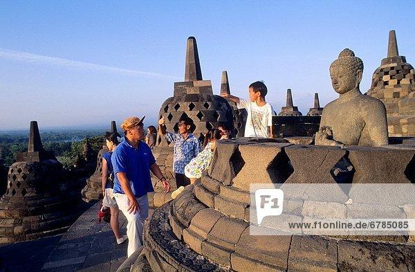 Tourists in Borobudur Buddhist Temple Java Indonesia