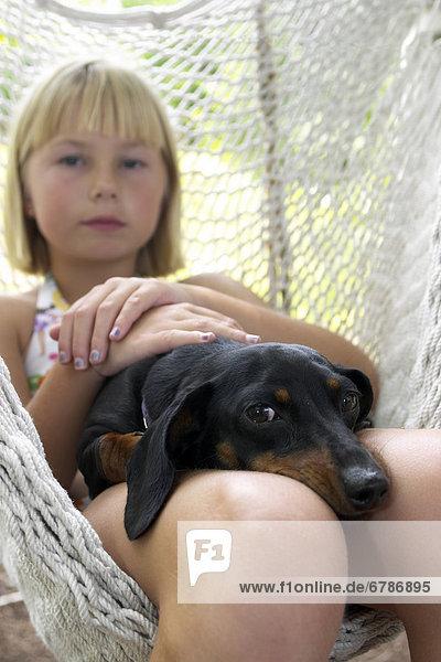 Girl and Dog in Hammock